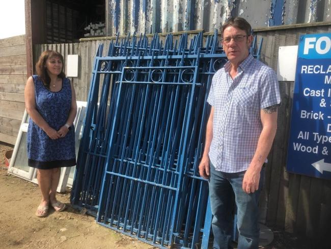 Offer - Mick and Catherine Spindler with the salvaged railings they have offered to Essex County Council
