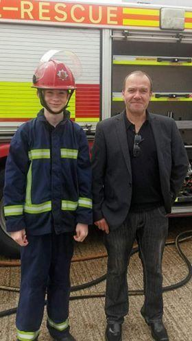 John Gray pictured with step father Kevin Gray at a fire service training day