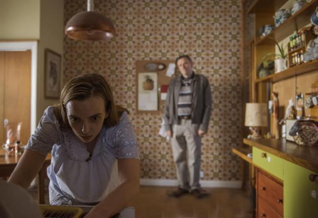 Villanelle (Jodie Comer), takes refuge in Julian (Julian Barratt)'s house in Killing Eve. Picture from Sid Gentle, photographed by Parisa Taghizadeh